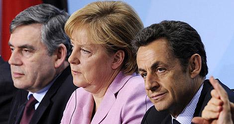 Gordon Bronw, Angela Merkel y Nicolas Sarkozy en Berlín. | AFP