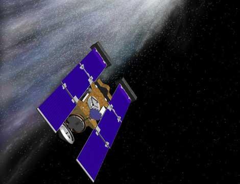 Recreación artística de la sonda Stardust atravesando la cola del cometa. | NASA - JPL.