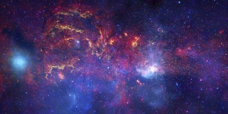 Imagen óptica-infrarroja-X del Centro Galáctico. | NASA, ESA, SSC, CXC, STSci.