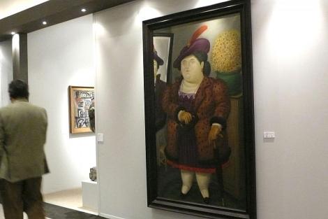 El cuadro 'Mujer con abrigo de piel', de Fernnado Botero, podía comprarse en la feria. | Efe