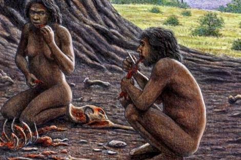 Un homínido de Atapuerca parte carne con la diestra.  Mauricio Antón