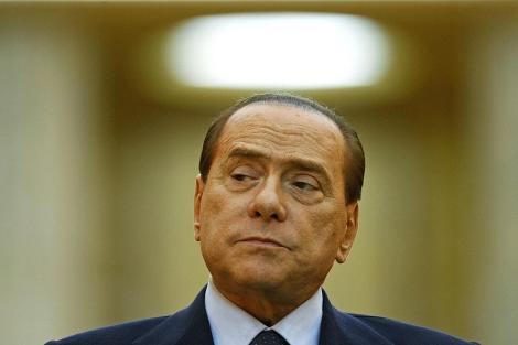 El primer ministro italiano, Silvio Berlusconi, en Bucarest. | Reuters