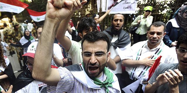 Protesta por la muerte de un niño presuntamente torturado por las fuerza de seguridad sirias. | Efe