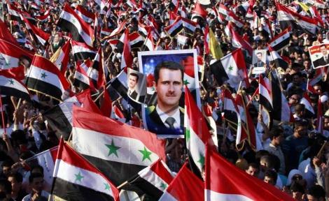 Simpatizantes de Assad, congregados en una manifestación de apoyo a su presidente. | Efe