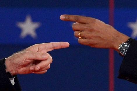 Romney y Obama se señalan mutuamente en su primer debate electoral. | AFP