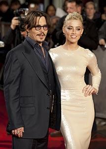 Con Amber Heard. | Gtres
